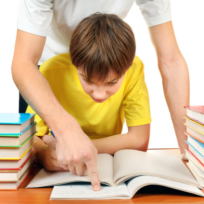Parent help to Son with Homework on the White Background